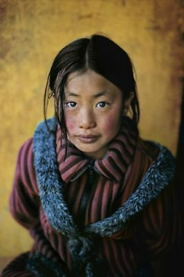 Steve McCurry (1950-) - Girl in a Chinese Coat, Xingazê, Tibet, 2001