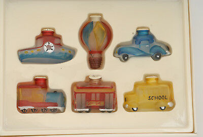 lot of antique-looking glass covers for miniature LED bulbs