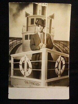 Vintage Young Man Standing On Boat Backdrop Post Card Circa 1909