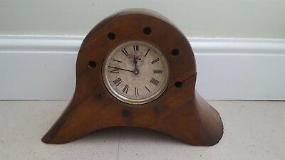 Unusual Ansonia clock movement mounted into wooden propeller center c1900.