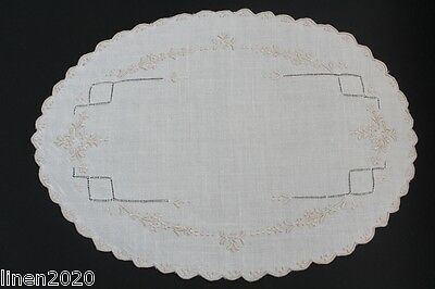 Vintage cream linen embroidered oval shaped cloth.