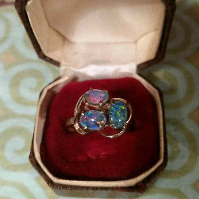 Gold ring with 3 black opals