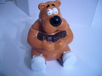 Bear candy/cookie jar. 1999 Your Favorite Company Inc. Bear holding Chocolate