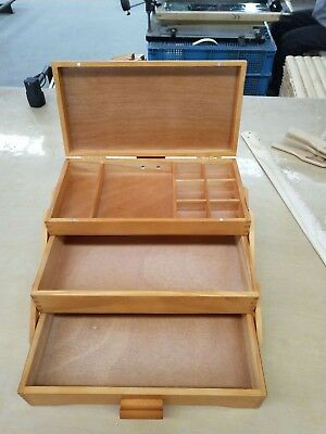 wooden sewing box with 3 drawers.