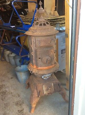 """Antique Red Oak 51"""" Tall Ornate Cast Iron Pot Belly Stove - Good"""