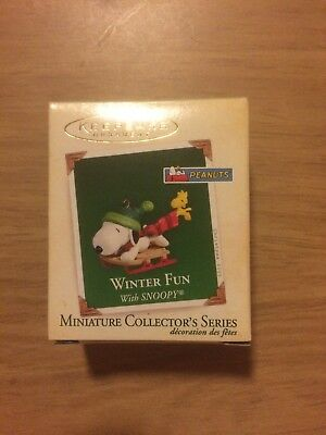 The 2005 Peanuts Hallmark WINTER FUN WITH SNOOPY Christmas Ornament