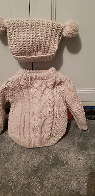 babies handknitted aran jumper with matching pompom hat