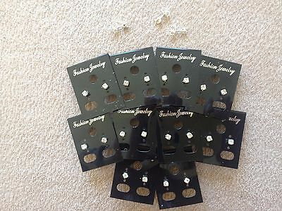 JOB LOT-20 pairs of 0.4cm crystal diamante stud earrings.Silver plated.UK make.