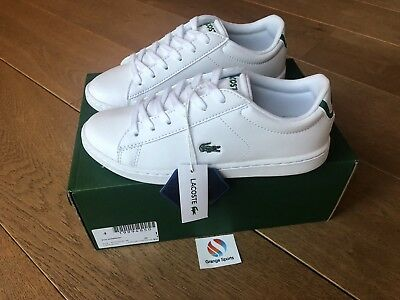 c5f404c49 Lacoste Junior Boys Girls White Carnaby EVO 318 Trainers Brand New Boxed