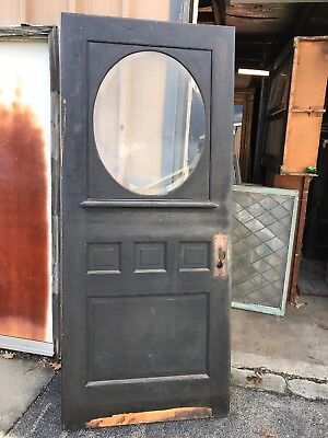 CM63 antique quartersawn oak half glass beveled entrance door 35.75 x 84