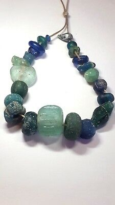 Ancient beads.23 ancient Roman glass beads.very rare.