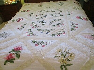 Vintage handmade vintage quilt 78 X 66 light and airy Flowers are on the materia