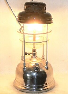 Vintage Tilley X246 kerosene strom lamp, clean with new seals, burns great.