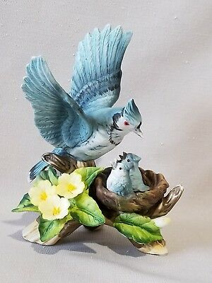 Adorable ceramic Blue Jay mother with her babies in a nest figurine!