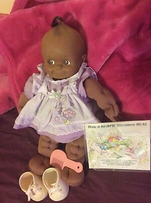 Vintage large black  18 inch kewpie doll baby comes with original book, outfit