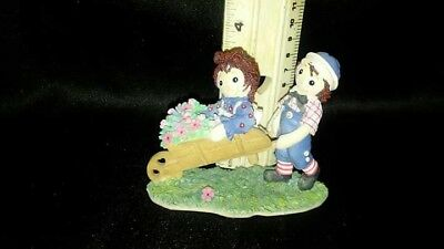 """Raggedy Ann and Andy """"SCATTER SEEDS OF HAPPINESS WHEREVER YOU MAY GO""""  Enesco"""