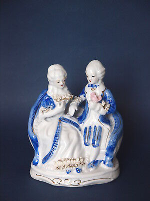 Blue and White Gilded Porcelain Figure of Seated Couple in Period Dress