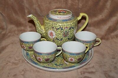 Chinese porcelain Famille Jaune yellow tea pot with lid, four (4) cups and tray