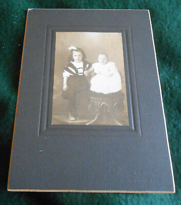 Circa 1910 Photo on card of Two Children w/ Chair