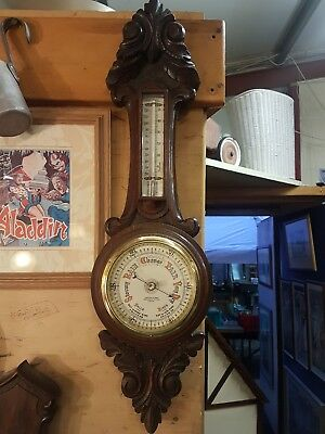 VINTAGE BAROMETER AND THERMOMETER IN DECORATIVE WOODEN CASE. sold due timewaster