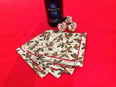 Set Of Four Cotton Fabric Christmas Table Napkins With Ribbon Trim Cream Holly