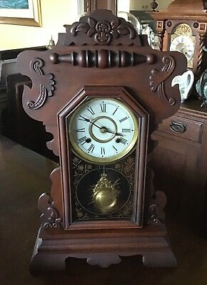 """An antique 22.5"""" tall New Haven gingerbread clock. full working order."""