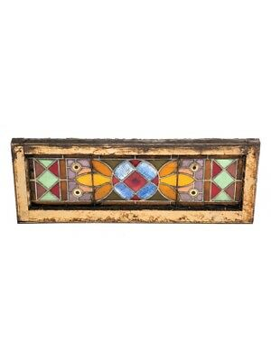 Victorian Era Stained Glass Window Accentuated With Uniquely Colored Rondels