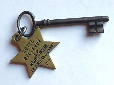 Antique brass hotel key France