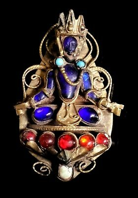 Tibetan Nepalese Himalayan brass and glass deity brooch