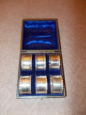 Antique Victorian satin velvet boxed set of 6 silver plated fluted napkin rings.