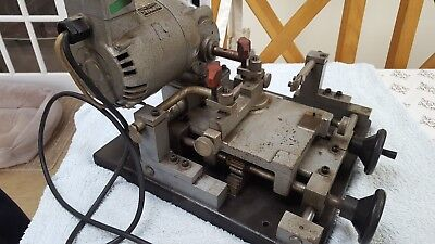 Key cutting machine. Used condition. Motor runs well. Believed to be a mortice m