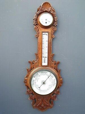 Lovely 19th century carved honey/light Oak barometer,thernometer and a clock