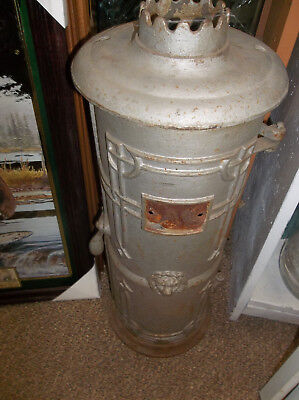 Antique Cast Iron Lion's Head Water Heater