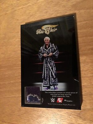 WWE 2K19 Commemorative Plaque featuring a piece of a robe, worn by Ric Flair!