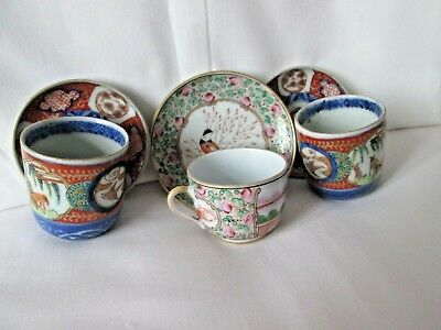 Three miniature Chinese porcelain cups and saucers