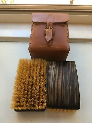 2 Vintage wood & nylon ? bristle clothes brushes in leather case.Made in England