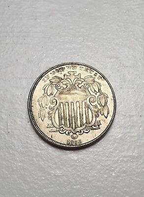 1866 shield nickel with rays.  Rare first year coin in great shape