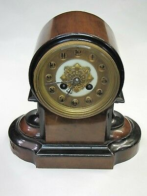 A Small French Striking Mantle Clock in Shaped Case