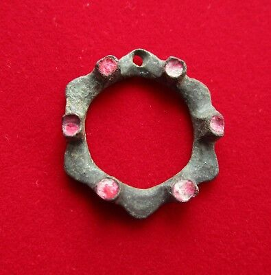 Beautiful with red paste decorated ancient Celtic bronze  pendant .