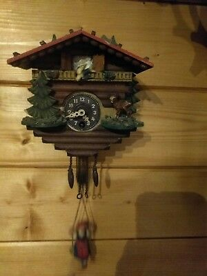Rare chalet black forest bobbing lady clock.