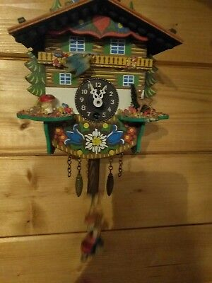Small black forest bobbing lady clock wall clock