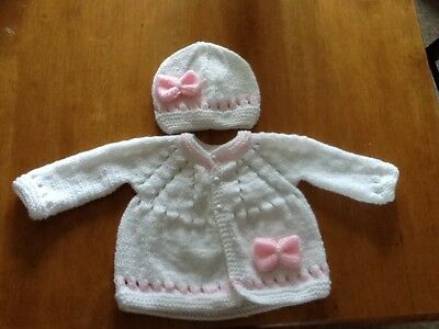 Hand knitted cardigan and hat in White/pink newborn)