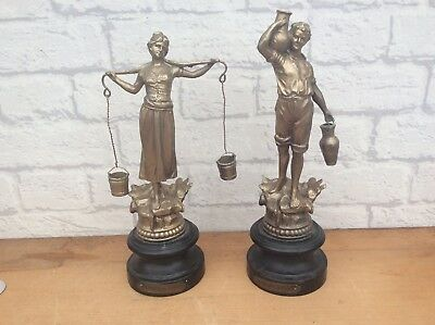 A Pair Of Antique Spelter Classical Figures. Male and Female Water Carriers
