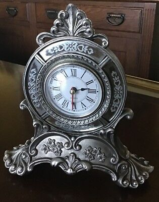 A Small Silver Coloured Quartz Movement Mantel Clock. Battery Operated. Running.