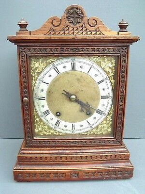 Charming late 19th century ornately carved oak mantle clock