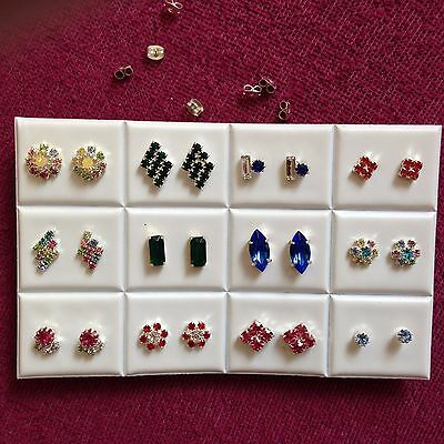 JOB LOT-12pairs of different shapes colour diamante stud earrings.Silver plated.