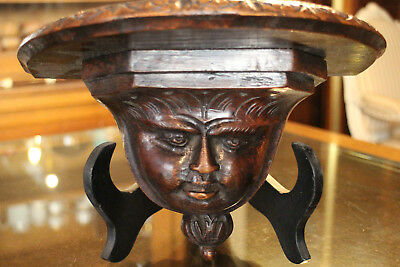 Console applique solid oakwood sculpture pattern face character shelf console