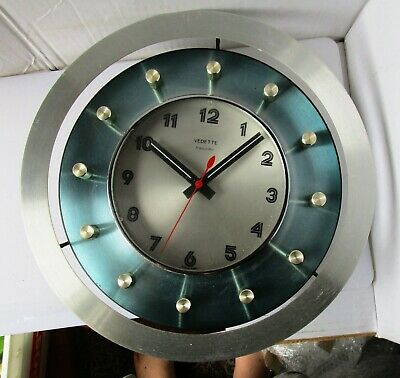 Wonderful Blue Metal Battery Wall Clock from VEDETTE