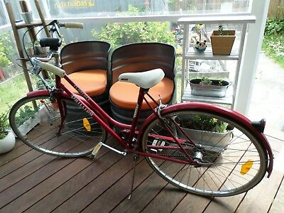 Vintage Florence Phillips bicycle with red frame & white seat and handles