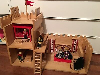 High quality wooden toy castle with king, queen, courtiers, horses and props.